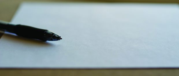 image of a pen on paper