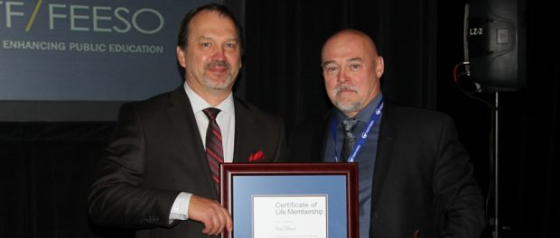 Photo of Harvey Bischof, President-elect presenting outgoing President Paul Elliott with OSSTF/FEESO Life Member Award