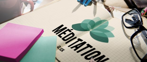 Image of a booklet an a pen on a desk that says mediation.
