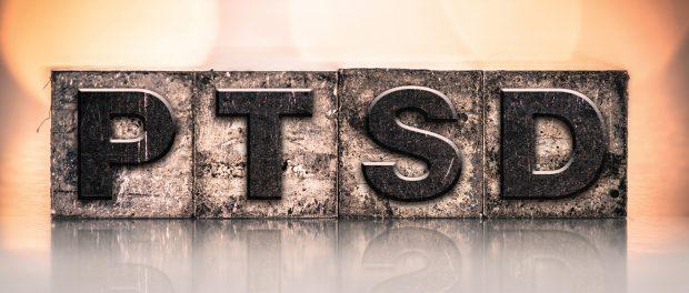 Image of block letters spelling PTSD