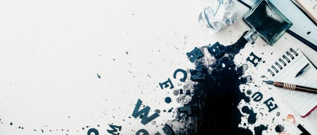 Illustration: spilled ink, crumpled paper, scattered letters,