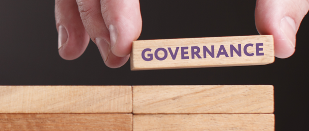 Photo of hand showing a block with the word: Governance