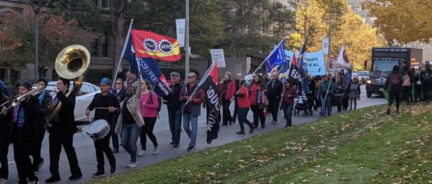 Photo of protesters marching at Queen's Park