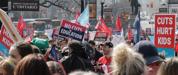Photo of people protesting education cuts at Queen's Park