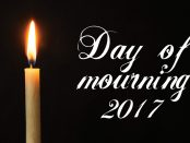 Image of a burning candle on black background with the words Day of mourning 2017 beside it.