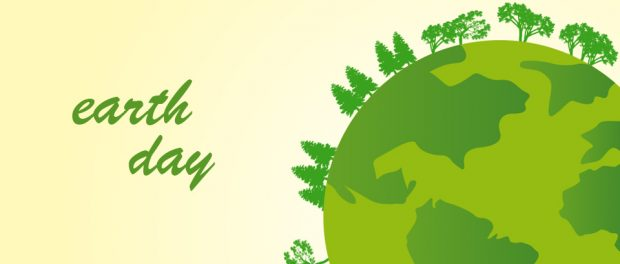 An illustration of a green earth with trees growing along the perimeter. The words earth day are also present.