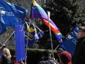 Photo of OSSTF/FEESO members marching with flags at Queen's Park.