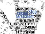 Illustration of a hand with stop harassment words throughout