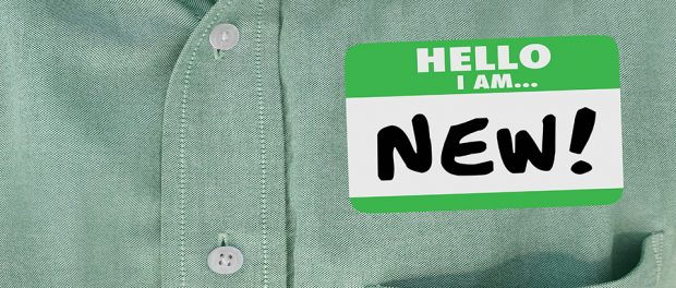 "Photo of a close-up of a shirt pocket with a ""hello my name is new"" sticker on it."