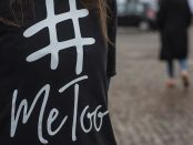 Photo of a person wearing t-shirt with #MeToo written on it.