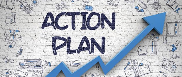Graphic of a simulated brick wall with the words Action Plan spray painted on it