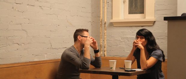 Image of a young man and woman in coffee shop