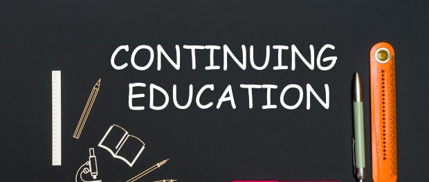 An illustration of a black board with the words continuing education written on it