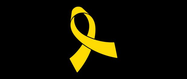 Image of a yellow ribbon on a black background