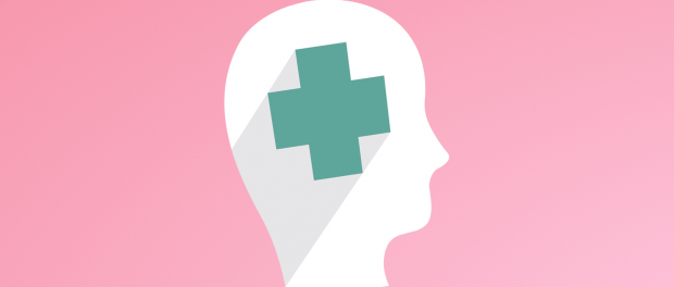 Illustration of white silhouette head and first aid symbol